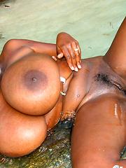 Big black tits on the wild beach