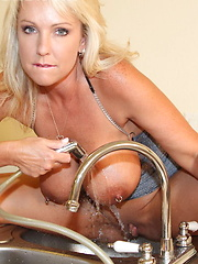 Super hot blonde plays in the in the kitchen sink