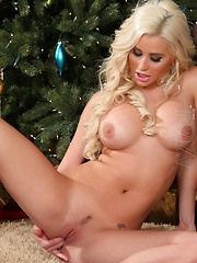 Sexy Spencer Scott shows off her sexy holiday outfit, then poses naked by the tree.