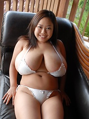 Sexy big titted Fuko posing in bikini her huge tits