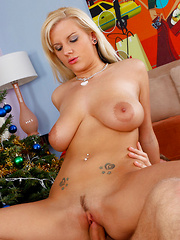Sexy blonde Haley Cummings rides a cock by the Christmas Tree.