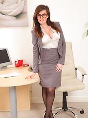 Sexy specced brunette in black stockings
