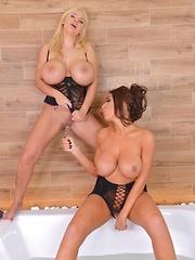 Bathtub Titty Twins: Two Lesbian Babes Masturbate With Glass Dil