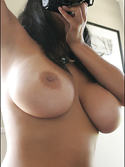 Two naughty busty babes taking each others pictures