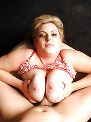 Busty blonde licks cum off her natural tits.