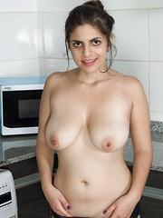 Anastasia Cherry enjoys stripping in kitchen