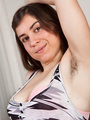 Busty Mercedez shows her hairy pits and hairy pussy
