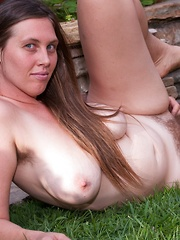 Busty Lindsay strips in outdoor pictorial